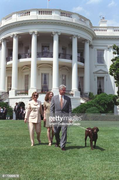 President William Jefferson Clinton First Lady Hillary Rodham Clinton and Chelsea Clinton walking pet Buddy the Dog on the South Lawn of the White...
