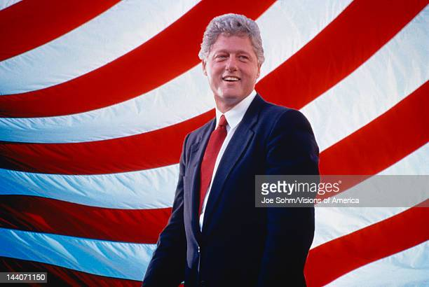 President William Jefferson Clinton in front of American flag stripes