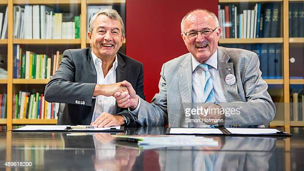 President Wolfgang Niersbach and Heinz Hilgers President of Child Protection Association shake hands after signing a contract at DFB Headquarters on...