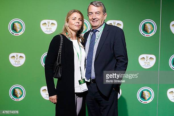 DFB president Wolfgang Niersbach and his girlfriend Marion Popp pose for a photo at the green carpet prior to the DFB Cup Final between Borussia...