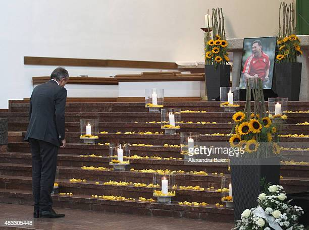 DFB president Wolfgang Niersbach bowsin front of a photograph of recentlydeceased Stephan Beckenbauer during the memorial service at Hl Familie...