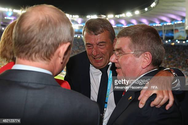 President Wolfgang Niersbach celebrate winning the World Cup with German Chancellor Angela Merkel, Russian President Vladimir Putin and IOC President...