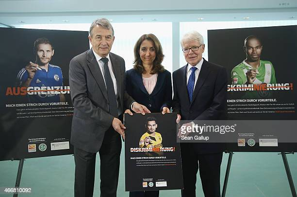 DFB President Wolfgang Niersbach German Integration Commissioner Aydan Ozoguz and DFL President Reinhard Rauball present campaign posters for the new...