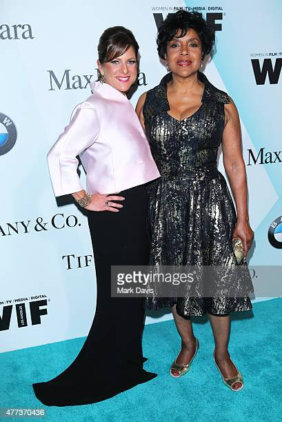 President Women In Film Cathy Schulman wearing Max Mara and actress Phylicia Rashad attend the Women In Film 2015 Crystal Lucy Awards Presented by...