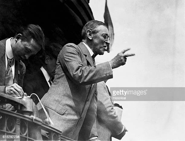 President Woodrow Wilson delivers a speech from the back of a train.
