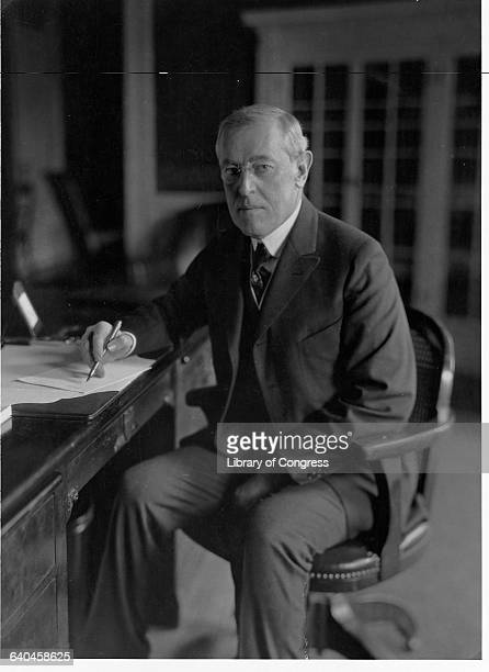President Woodrow Wilson the 28th President of the United States writes at his desk