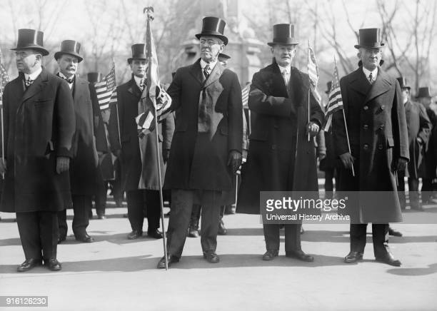 President Woodrow Wilson , Vice President Thomas Marshall to Wilson's left, Holding American Flags during Parade Honoring Wilson's Return from Paris...
