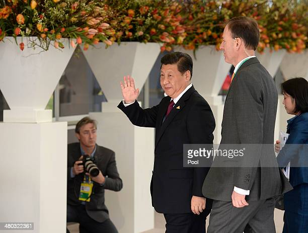 President Xi Jinping of China arrives for the opening session of the at the 2014 Nuclear Security Summit on March 24 2014 in The Hague Netherlands...