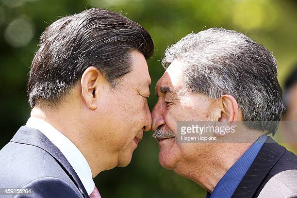 President Xi Jinping Of China is greeted with a hongi by Government House Kaumatua Lewis Moeau during a State Welcome at Government House on November...