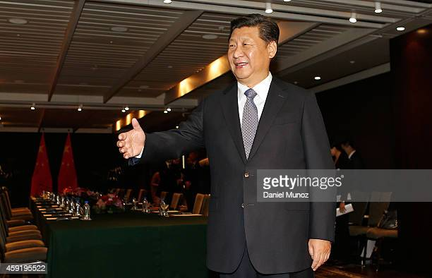 President Xi Jinping of China welcomes New South Wales Premier Mike Baird at the Four Season Hotel on November 19 2014 in Sydney Australia President...