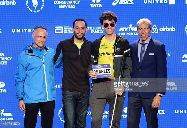 President/CEO, New York Road Runners Michael Capiraso, guest, runner from athletes with disabilities division, Charles-Edouard Catherine and...