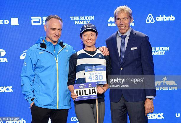 President/CEO, New York Road Runners Michael Capiraso, volunteer pacer Julia Khvasechko and President of Events, New York Road Runners Race Director,...