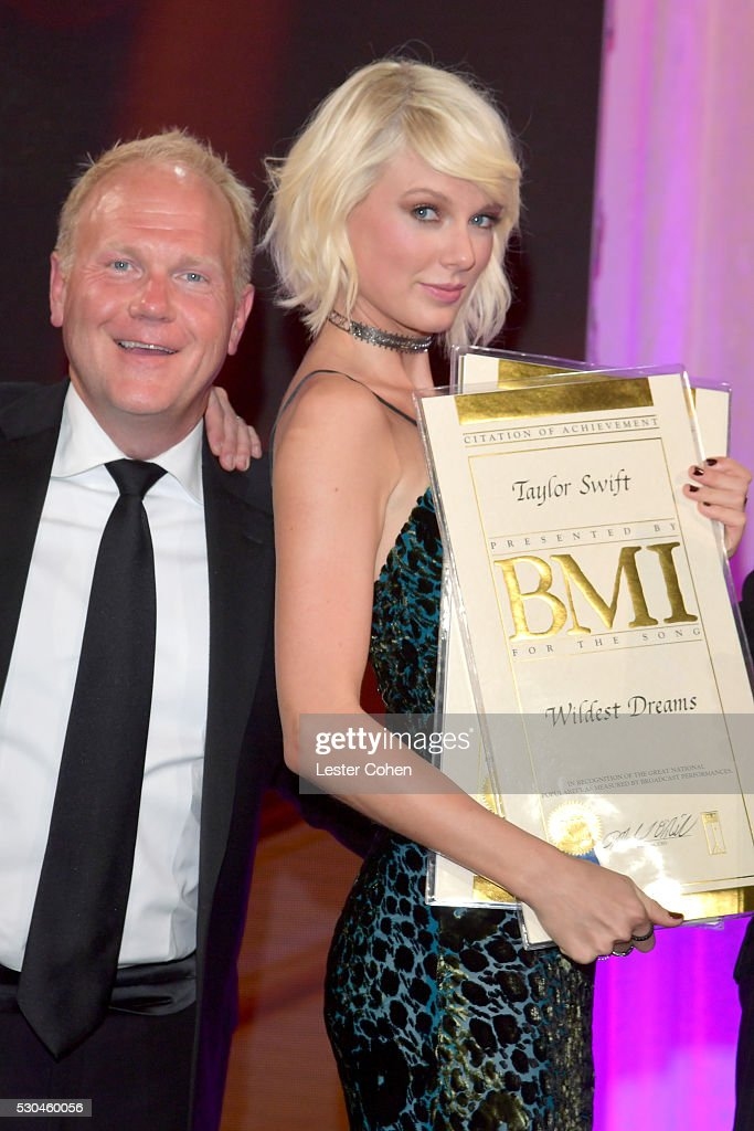 President/CEO of Sony/ATV Music Publishing Nashville Troy Tomlinson (L) and honoree Taylor Swift pose with award onstage at The 64th Annual BMI Pop Awards, honoring Taylor Swift and songwriting duo Mann & Weil, at the Beverly Wilshire Four Seasons Hotel on May 10, 2016 in Beverly Hills, California.