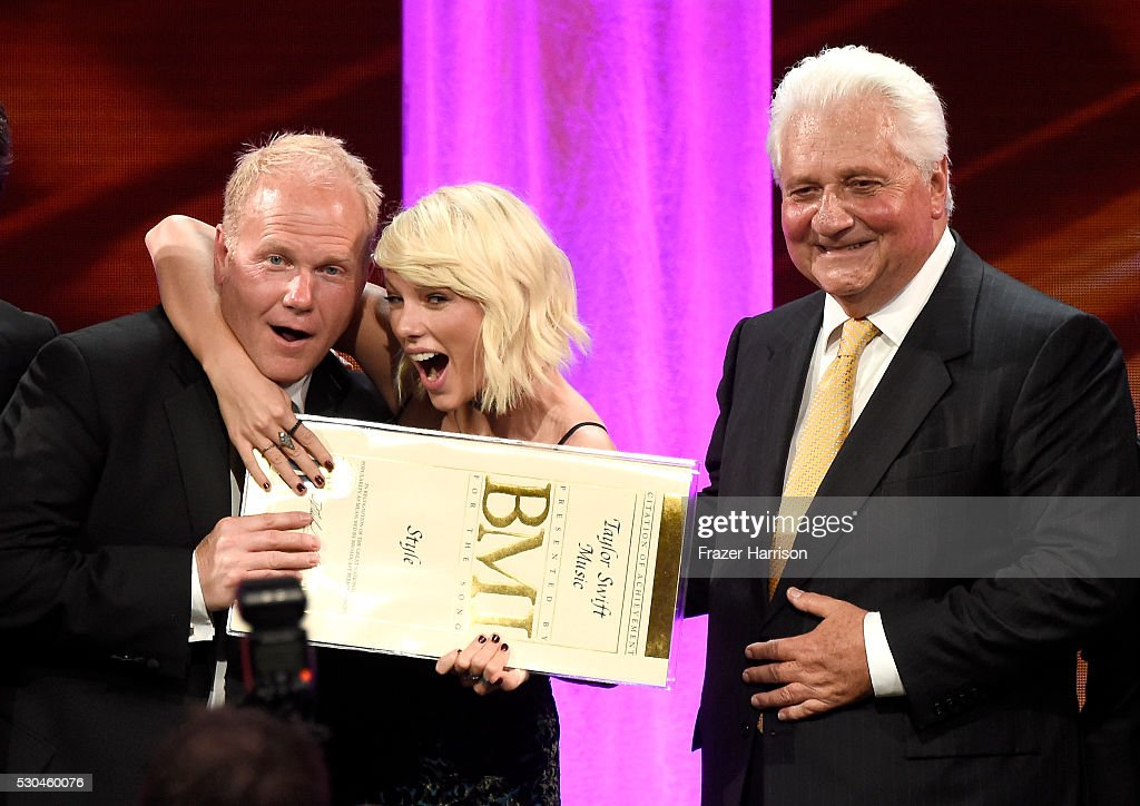 President/CEO of Sony/ATV Music Publishing Nashville Troy Tomlinson, honoree Taylor Swift, and Sony/ATV CEO Martin Bandier pose with award onstage at The 64th Annual BMI Pop Awards, honoring Taylor Swift and songwriting duo Mann & Weil, at the Beverly Wilshire Four Seasons Hotel on May 10, 2016 in Beverly Hills, California.