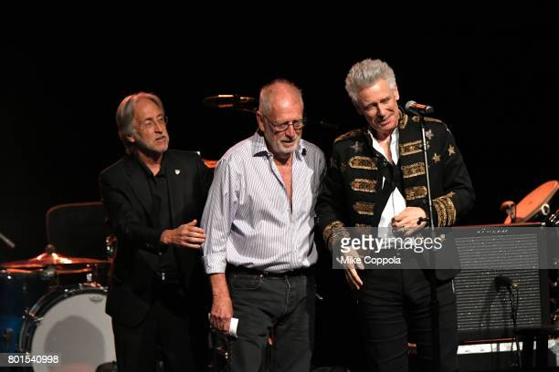 President/CEO of The Recording Academy and MusicCares Neil Portnow and Chris Blackwell present and Honoree Adam Clayton of U2 with Stevie Ray Vaughan...