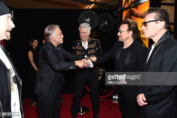 President/CEO of The Recording Academy and MusicCares Neil Portnow greets Bono and Honoree Adam Clayton of U2 as The Edge and Larry Mullen Jr of U2...