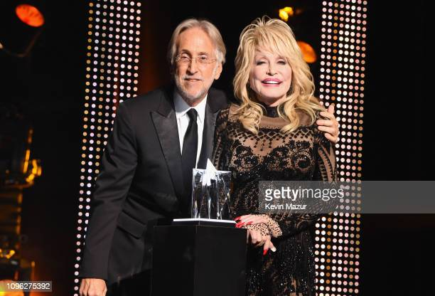 President/CEO of the Recording Academy and President/CEO of MusiCares Neil Portnow presents the MusiCares Person of the Year award to Dolly Parton...