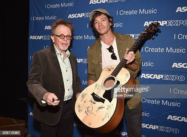 President/Chairman Paul Williams and singersongwriter Nate Ruess pose with a #StandWithSongwriters guitar which will be presented in May to members...
