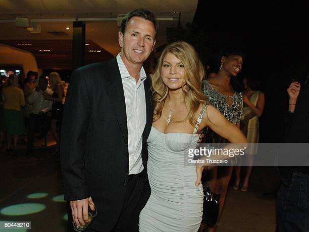 LAS VEGAS MARCH 27 President/Chief Executive Officer of the Mirage Scott Sibella and singer Fergie at Fergie and Quentin Tarantino's birthday...