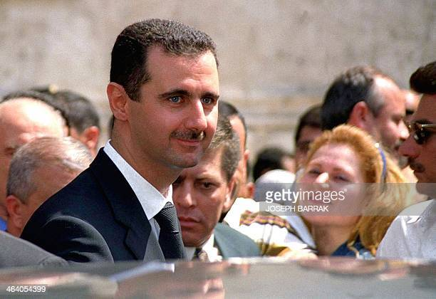 Presidentdesignate Bashar alAssad smiles at the crowd gathered in front of a polling station in Damascus 10 July 2000 Bashar is the sole candidate to...