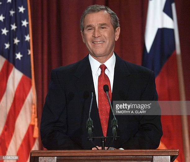 US presidentelect and Texas Governor George W Bush stands at the podium at the Austin State Capitol 13 December 2000 for his acceptance speech to...