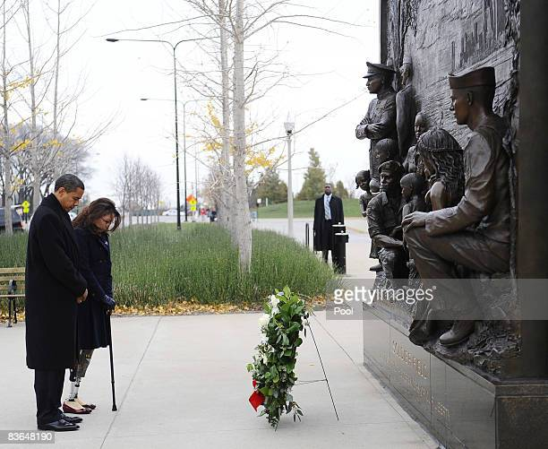 US Presidentelect Barack Obama and Gulf War veteran Tammy Duckworth both their heads after placing a wreath to honor America's veterans on Veterans...
