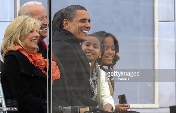 US Presidentelect Barack Obama and his daughters and vicepresidentelect Joe Biden and his wife Jill enjoy the 'We Are One concert one of the events...