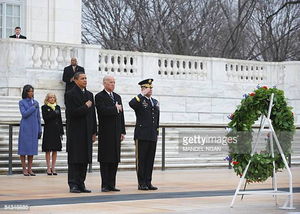 US Presidentelect Barack Obama and his wife Michelle along with vice presidentelect Joe Biden and his wife Jill pay their respects after laying a...