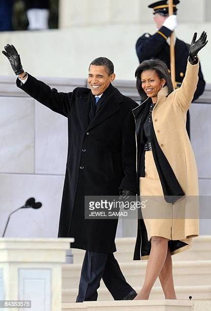 US Presidentelect Barack Obama and his wife Michelle arrive at the 'We Are One concert one of the events of Obama's inauguration celebrations at the...