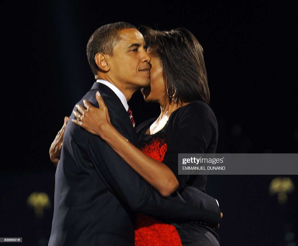 US president-elect Barack Obama and his wife Michelle embrace on stage during their election night victory rally at Grant Park on November 4, 2008 in Chicago, Illinois. Americans emphatically elected Democrat Obama as their first black president in a transformational election which will reshape US politics and the US role on the world stage. AFP PHOTO/Emmanuel DUNAND