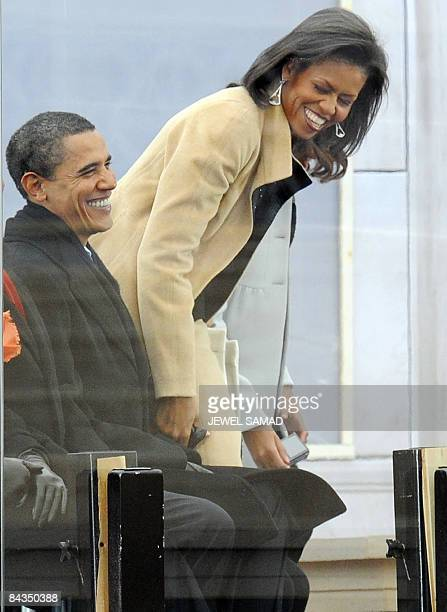 US Presidentelect Barack Obama and his wife Michelle enjoy the 'We Are One concert one of the events of Obama's inauguration celebrations at the...