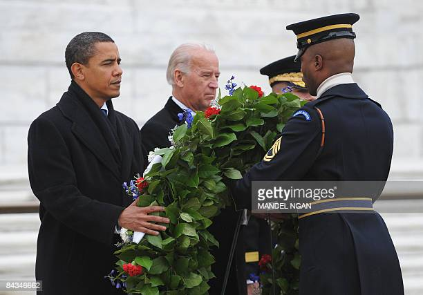 US presidentelect Barack Obama and vice presidentelect Joe Biden lay a wreath at the Tomb of the Unknown Soldiers on January 18 2009 at the Arlington...