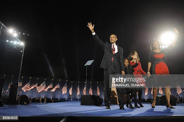 President-elect Barack Obama appears on stage with his wife Michelle and daughters Sasha and Malia for his victory speech at his election party in...