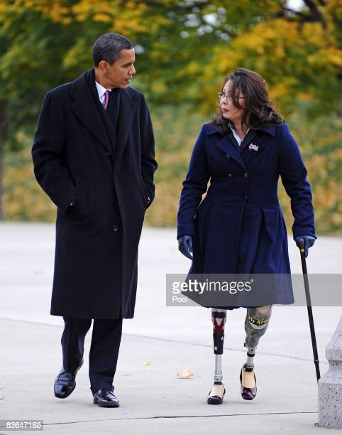 US Presidentelect Barack Obama arrives with Gulf War veteran Tammy Duckworth to honor America's veterans on Veterans Day at the Bronze Soldiers...