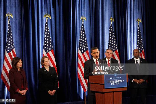 S Presidentelect Barack Obama at podium introduces prospective members of his cabinet at a news conference in Chicago Illinois US on Friday Dec 19...