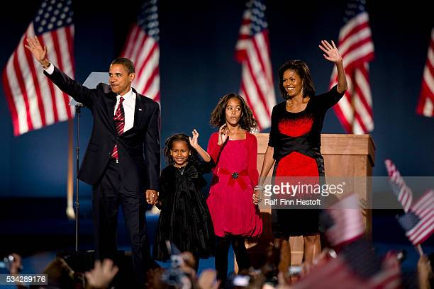 Presidentelect Barack Obama his wife Michele and daughters Sasha and Malia are introduced to the crowd of supporters in Chicago's Grant Park as the...