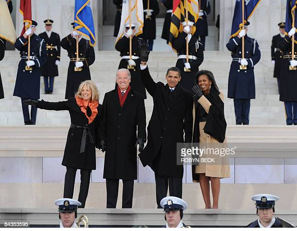 US Presidentelect Barack Obama his wife Michelle vice presidentelect Joe Biden and his wife Jill arrive at the 'We Are One concert one of the events...