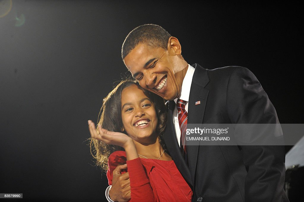 President-elect Barack Obama hugs his daughter Malia following his victory speech at his election party in Chicago November 4, 2008.