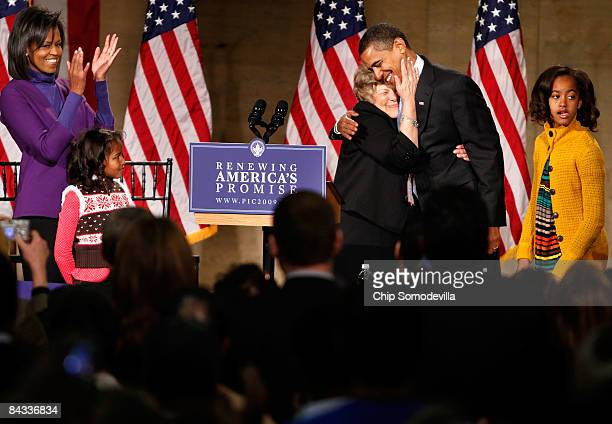 S Presidentelect Barack Obama is embraced by supporter Patricia Stiles after taking the stage with his wife Michelle Obama daughter Sasha and Malia...