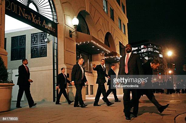US Presidentelect Barack Obama is surrounded by Secret Service agents after leaving a party hosted by Assistant Senate Majority Leader Dick Durbin...