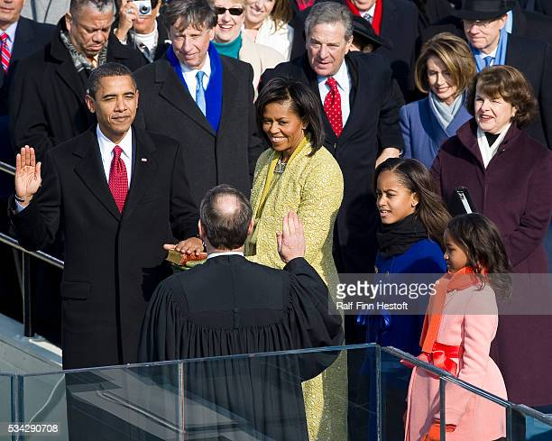 PresidentElect Barack Obama is sworn in by Chief Justice John Roberts as the 44th President of the United States during his Inauguration in...