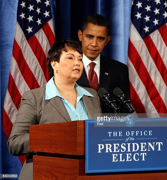 Presidentelect Barack Obama looks on as his choice to run the EPA the current chief of staff for New Jersey's governor Lisa Jackson speaks after...