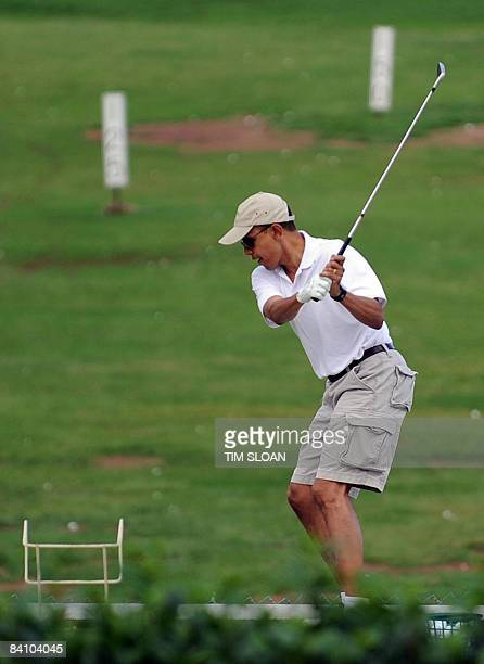 US Presidentelect Barack Obama takes a few swings at the driving range before a round of golf December 21 2008 near Kailua Hawaii Obama has boosted...
