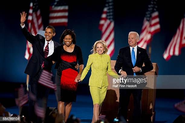 President-elect Barack Obama, Vice President Joe Biden and their families wave to the crowd after their election victory party in Chicago's Grant Park