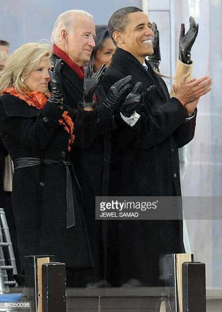 US presidentelect Barack Obama vice presidentelect Joe Biden as his wife Jill applaud during the 'We Are One concert one of the events of Obama's...
