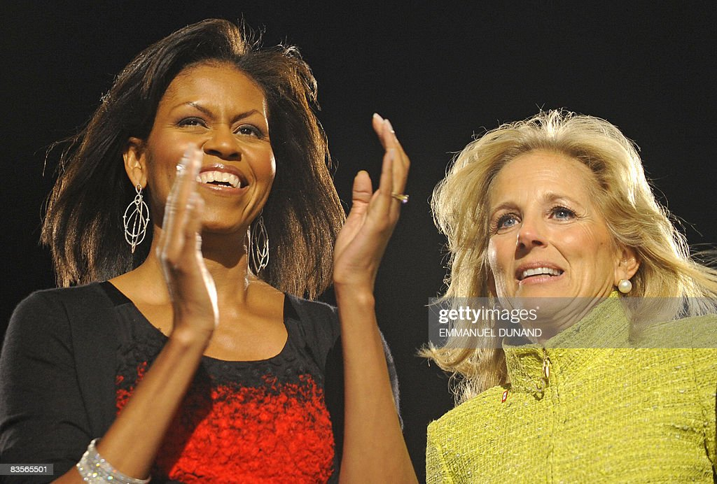 President-elect Barack Obama's wife Michelle (L) and Vice-President elect Joe Biden's wife Jill acknowledge the crowd following Obama's victory speech at his election party in Chicago, Illinois, on November 4, 2008.