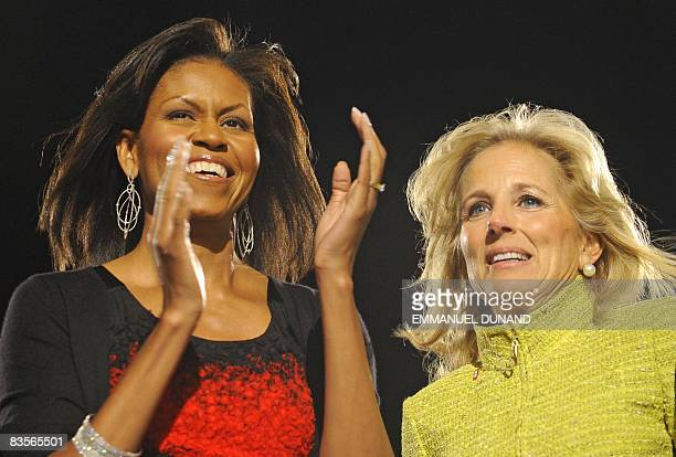 President-elect Barack Obama's wife Michelle and Vice-President elect Joe Biden's wife Jill acknowledge the crowd following Obama's victory speech at...