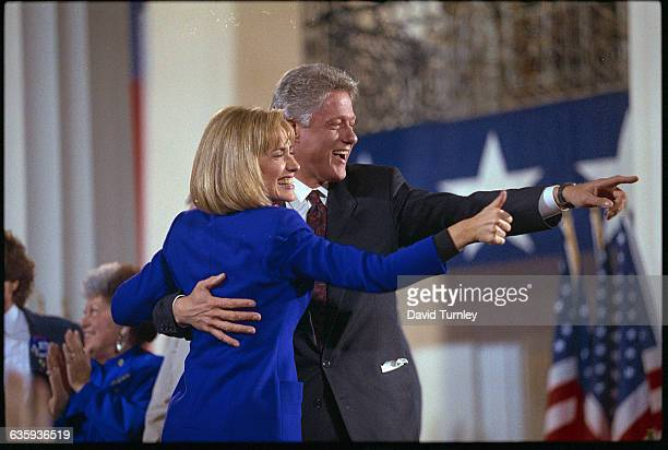 Presidentelect Bill Clinton and his wife Hillary acknowledge the crowd of supporters at a victory celebration at the Old State House in Little Rock...