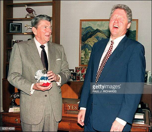 Presidentelect Bill Clinton breaks into a big laugh in Los Angeles 27 November 1992 as former US President Ronald Reagan presents him with a jar of...