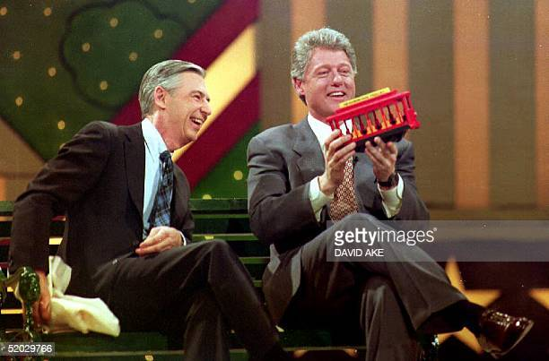 S Presidentelect Bill Clinton holds a trolley car given to him by Fred Rogers during the Presidential Inaugural Celebration for Children 19 January...